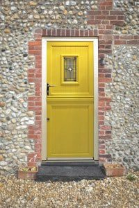 Yellow composite doors in a cottage