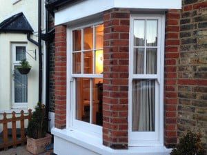 Timber look sliding window in PVCu.